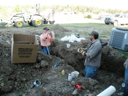 Discussing the intracacies of sewer installation