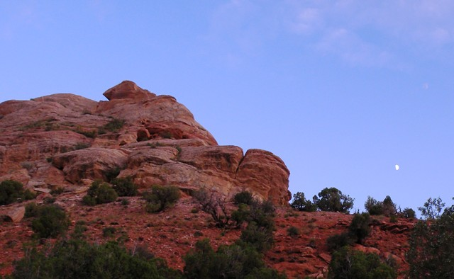 Moon over red rocks in Dinosaur