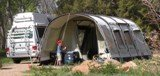 VW Bus with an Outwell Tent supplemental Living Space